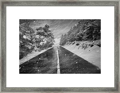 Snowstorm In The Road Framed Print by Guido Montanes Castillo