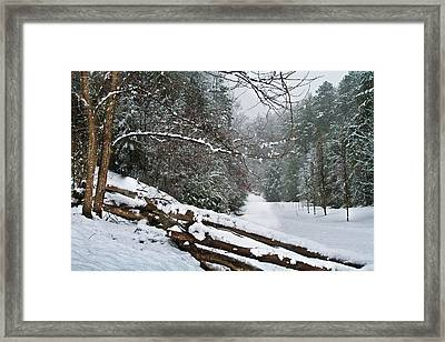 Snowy Fence Framed Print by Debra and Dave Vanderlaan