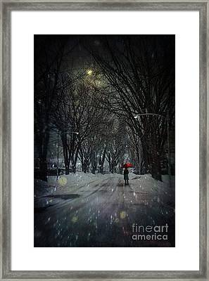 Snowy Winter Scene With Woman Walking At Night Framed Print by Sandra Cunningham
