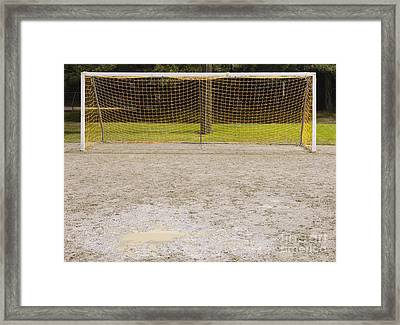 Soccer Net On Dirt Field Framed Print