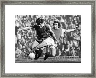 Soccer Tackle, 1976 Framed Print by Granger
