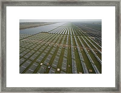 Solar Panels On Brackets Arrayed Framed Print by Michael Melford