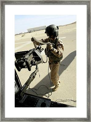 Soldier Carries 7.62 Mm Rounds Framed Print by Stocktrek Images