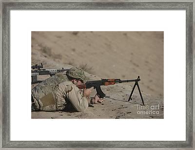 Soldier Fires A Russian Rpk Kalashnikov Framed Print by Terry Moore