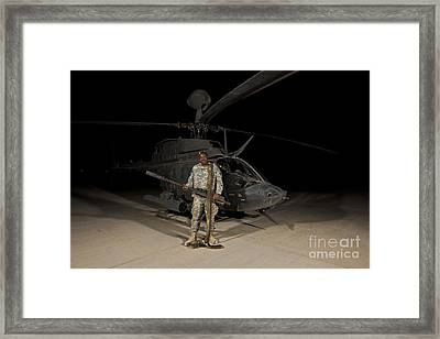 Soldier Holding A .50 Caliber Machine Framed Print by Terry Moore