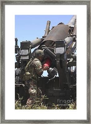 Soldier Loads A Charge Round Framed Print by Stocktrek Images