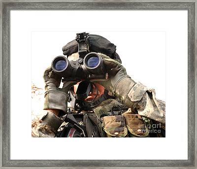 Soldier Looks Through A Set Framed Print by Stocktrek Images