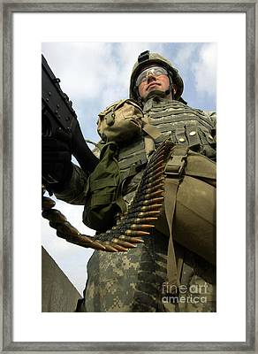 Soldier Mans A Vehicle Mounted 7.62 Mm Framed Print by Stocktrek Images