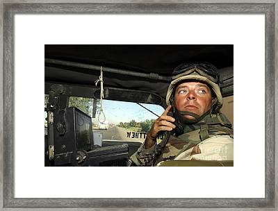 Soldier Monitors The Progress Of A 67 Framed Print by Stocktrek Images
