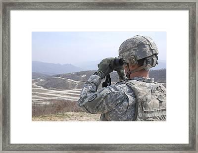 Soldier Observes An Adjust Fire Mission Framed Print by Stocktrek Images