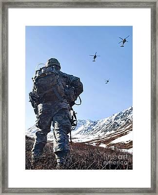 Soldier Patrols Through Alaska's Framed Print by Stocktrek Images
