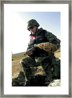Soldier Shows The Remains Of A Korean Framed Print