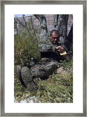 Soldier Takes Advantage Of A Break Framed Print by Stocktrek Images
