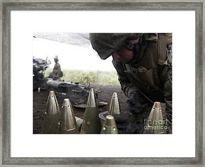 Soldier Tightens Fuses To Artillery Framed Print by Stocktrek Images