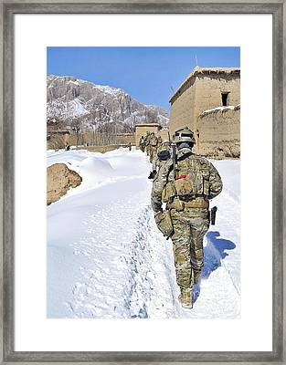 Soldiers Conduct A Patrol In Shah Joy Framed Print