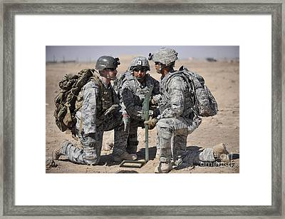 Soldiers Discuss A Strategic Plane Framed Print by Stocktrek Images