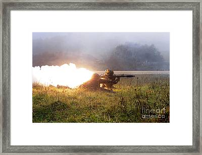 Soldiers Fire A Rocket Propelled Framed Print by Stocktrek Images