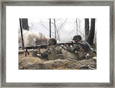 Soldiers Fire Their Weapons From A Fox Framed Print by Stocktrek Images