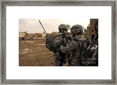 Soldiers Help One Another Framed Print by Stocktrek Images