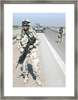 Soldiers Help Secure A Sector Framed Print