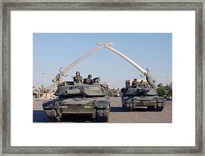 Soldiers In An Army Abrams Tank Pose Framed Print by Everett