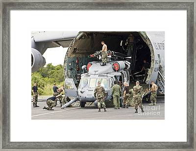 Soldiers Loading Helicopters Onto A C-5 Framed Print by Stocktrek Images