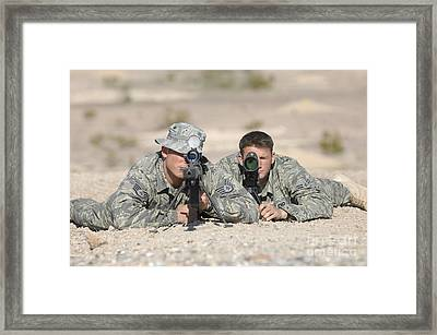 Soldiers Look Through The Scope Framed Print by Stocktrek Images