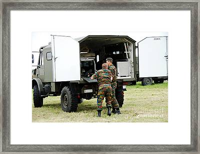 Soldiers Of An Infantry Section Framed Print by Luc De Jaeger