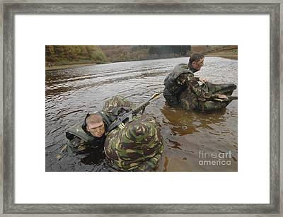 Soldiers Participate In A River Framed Print by Andrew Chittock