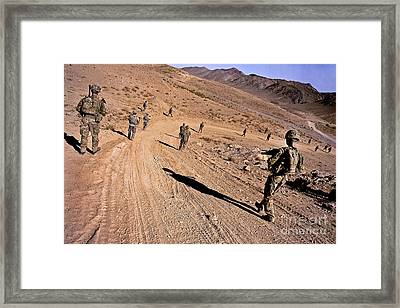Soldiers Patrol To A Village Framed Print
