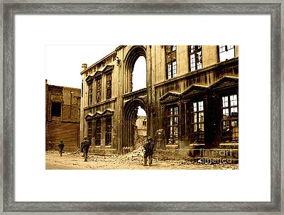 Soldiers Patrolling Past The Facade Framed Print by Stocktrek Images