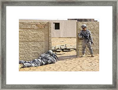 Soldiers Pull Security At A Mock Afghan Framed Print by Stocktrek Images