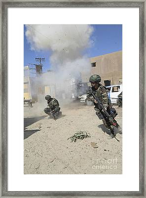 Soldiers React To A Simulated Framed Print