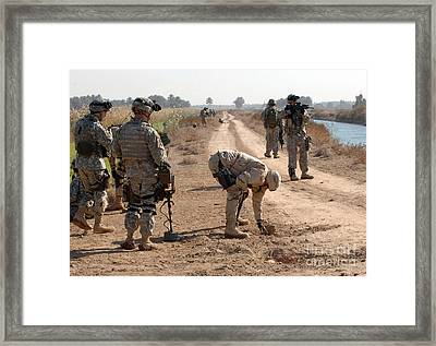 Soldiers Secure An Improvised Explosive Framed Print