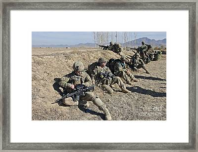 Soldiers Take Cover Behind A Berm Framed Print