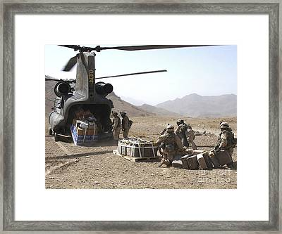 Soldiers Unload Supplies From A Ch-47 Framed Print