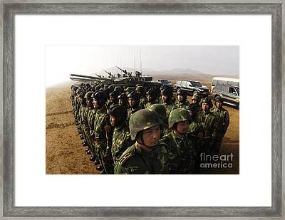 Soldiers With The Peoples Liberation Framed Print by Stocktrek Images