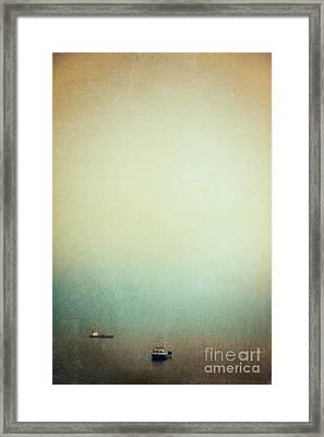 Solitary Ships Framed Print