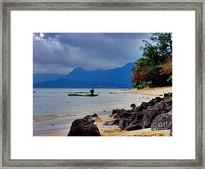 Solo Canoe Framed Print by Joe Finney