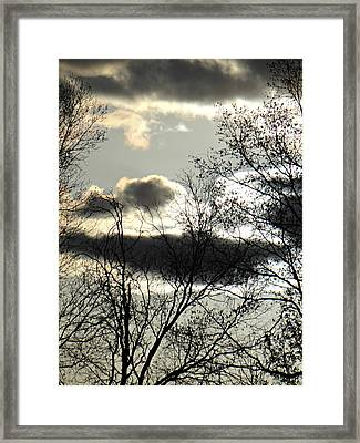 Some Rather Serious Looking Clouds Framed Print by Brenda Conrad