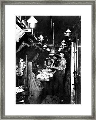 Sorting The Mail In A Railway Post Framed Print by Everett