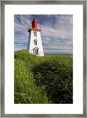 Souris Harbour Lighthouse, Souris Framed Print by John Sylvester