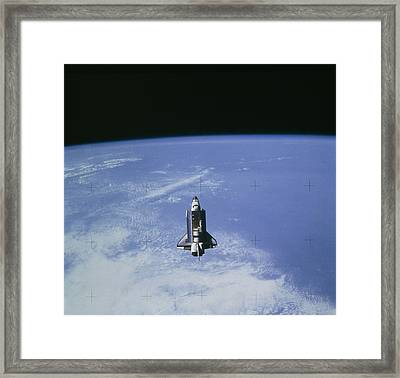 Space Shuttle Challenger Sts-7 Orbiting Earth. Framed Print by Nasa.