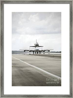 Space Shuttle Discovery Sits Atop Framed Print by Stocktrek Images
