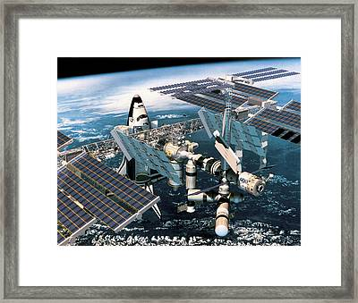 Space Shuttle Docked At The Space Station In Outer Space Framed Print by Stockbyte