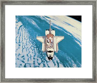 Space Shuttle In Orbit Around The Earth Framed Print by Stockbyte