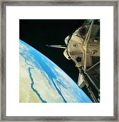 Space Shuttle Orbiting The Earth Framed Print by Stockbyte
