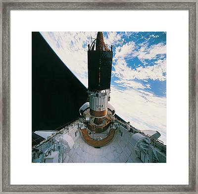 Space Shuttle Releasing A Satellite Framed Print by Stockbyte