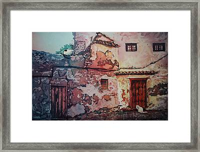 Spanish Courtyard Framed Print by Leslie Redhead