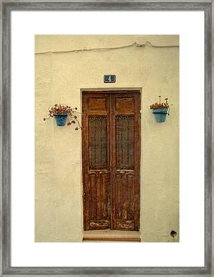 Spanish Doorstep Framed Print by Perry Van Munster